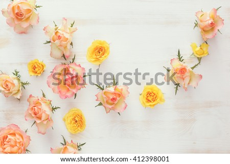 Fresh roses flower, abstract background. . Different color rose flowers  on rustic  background. Top view, vintage toned image, blank space - stock photo