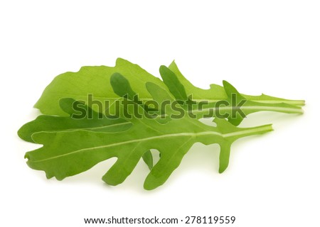 fresh rucola leaves (Eruca sativa)  on a white background - stock photo