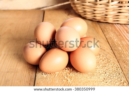 Fresh rural eggs on a wooden board, a slide - stock photo