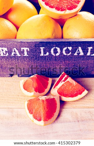 Fresh ryby red grapefruits in wood crate.
