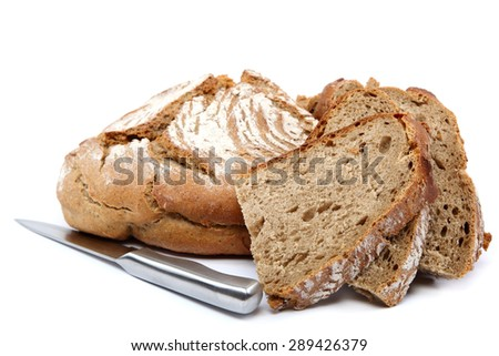 Fresh rye bread and knife isolated on white background. - stock photo