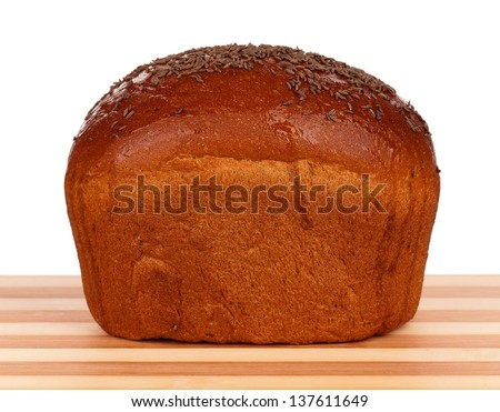 Fresh rye bread with caraway seeds on a cutting board on white background - stock photo