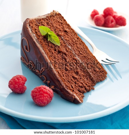 fresh sacher cake with raspberry - stock photo