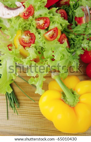 fresh salad and cherry's on wooden table - stock photo