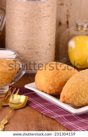 fresh salad and chicken chop and lemon - stock photo