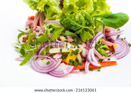 Fresh salad - Delicious fresh salad with tomatoes, lettuce, eggplant, zucchini, cheese, parma ham and olive oil. - stock photo