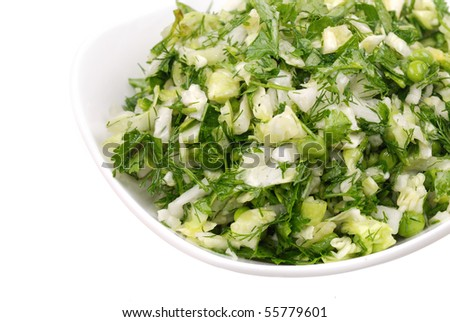 Fresh salad from vegetables and greens on a plate