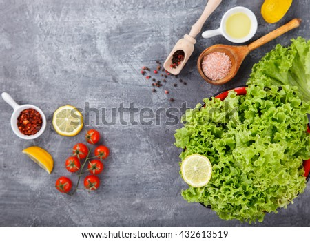 Fresh salad greens of lettuce with spices and fresh vegetables.Vegetarian and healthily cooking concept.Copy space.selective focus - stock photo