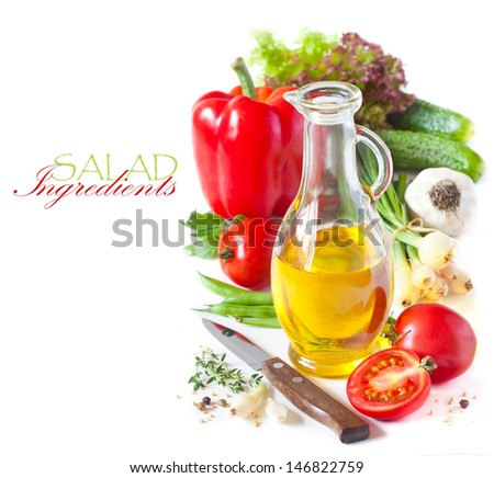 Fresh salad ingredients and olive oil on a white. - stock photo