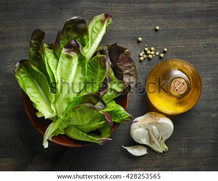 fresh salad ingredients on wooden table, top view - stock photo