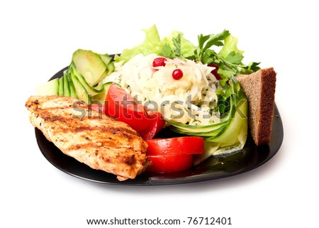 Fresh salad, meat, bread on black plate on white background - stock photo
