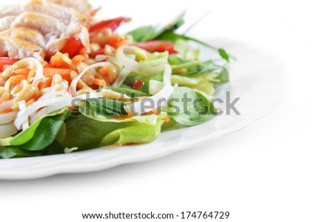 fresh salad of fried chicken, spinach and nuts