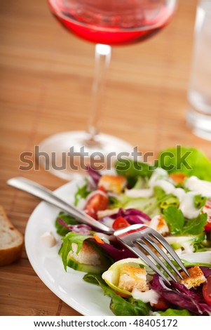 fresh salad on a white plate - stock photo