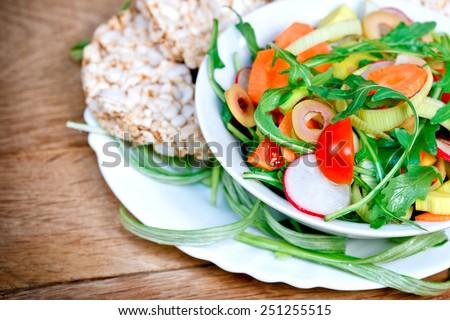 Fresh salad - vegan, vegetarian food - stock photo