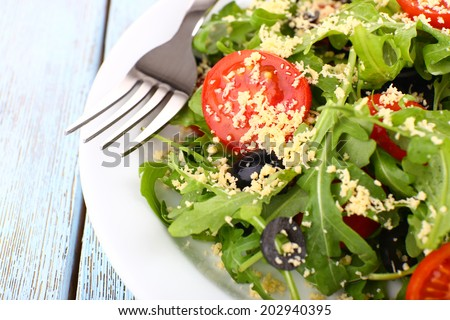 Fresh salad with arugula, close up - stock photo