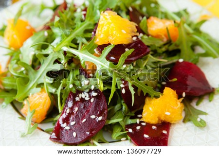 fresh salad with beets and oranges, closeup - stock photo