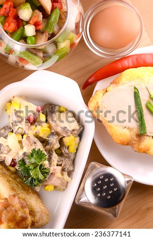 fresh salad with chicken chop and legs - stock photo