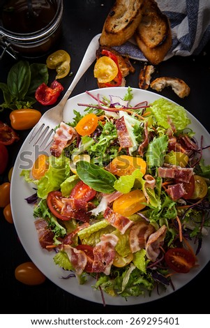 fresh salad with different lettuce types and tomatoes - stock photo
