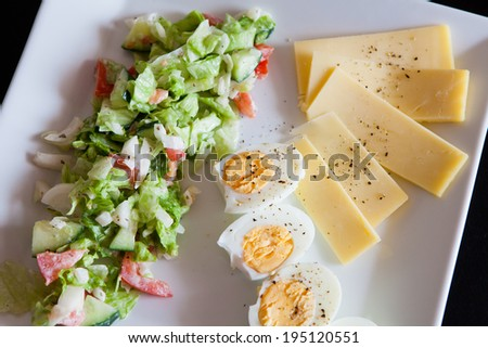 fresh salad with eggs and cheese - stock photo