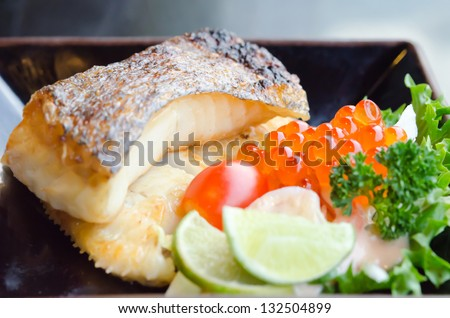 fresh salad with fish egg  and Japanese grilled cod fish  on plate