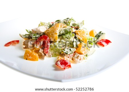 fresh salad with fruit on white plate - stock photo