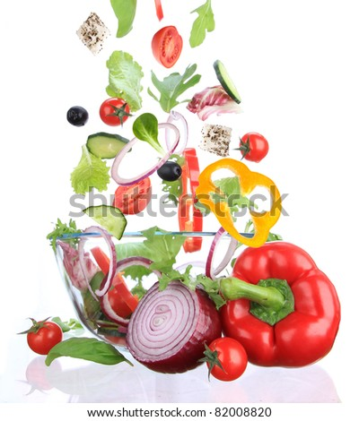 Fresh salad with ingredients in motion - stock photo