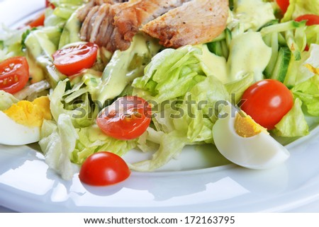 Fresh salad with lettuce, cherry  tomato and meat on dish
