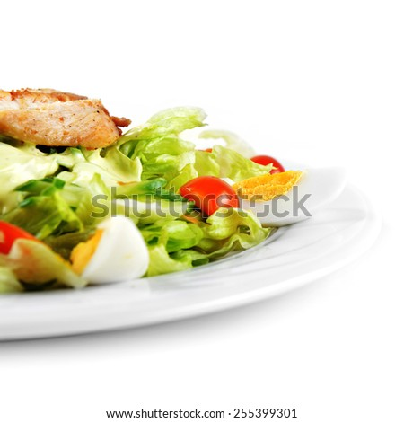 Fresh salad with lettuce, cherry  tomato and meat on dish - stock photo