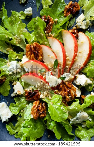 Fresh salad with pear, blue cheese and  walnuts   - stock photo
