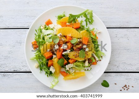 fresh salad with pumpkin and greens, food above - stock photo