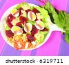 Fresh salad with red beets and hard boiled eggs with sardines - stock photo