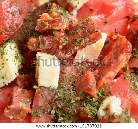 Fresh salad with sausage ham and various vegetables - stock photo