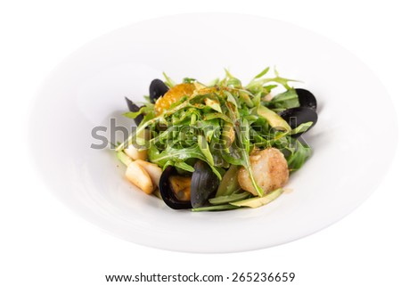 Fresh salad with scallops and mussel isolated on white background - stock photo