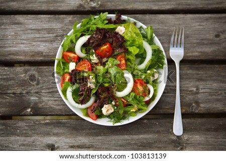 Fresh salad with tomatoes and cucumbers. on a table. - stock photo