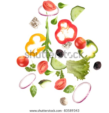 Fresh salad with vegetable in motion - stock photo