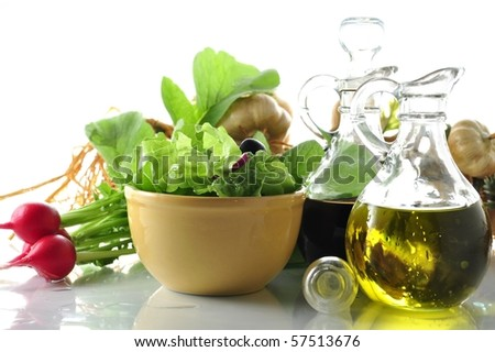 fresh salad with vinegar and olive oil - stock photo