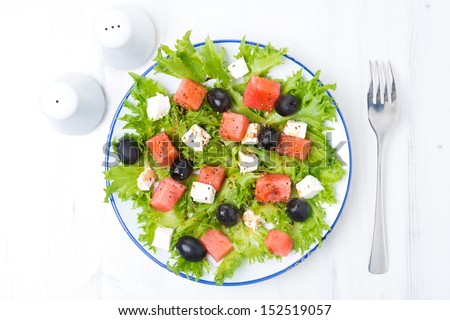fresh salad with watermelon, feta cheese and olives, horizontal, close-up