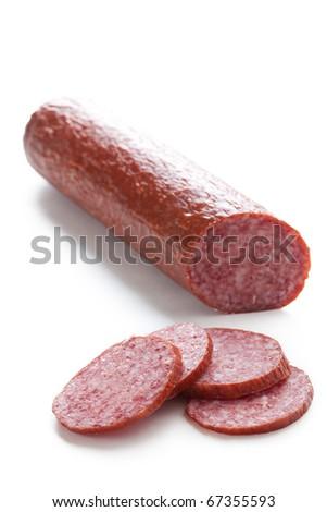 fresh salami on white background - stock photo