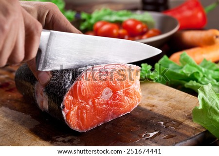 Fresh salmon. Cooking process. - stock photo