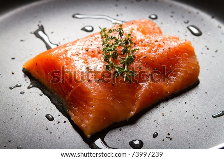 fresh salmon fillet on a frying pan - stock photo