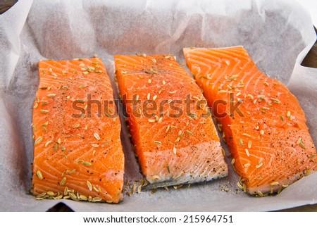 Fresh salmon fillet ready to cook - stock photo