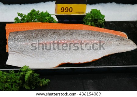 fresh salmon fish in supermarket, fresh fish meat on ice  - stock photo