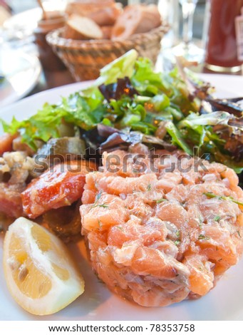 Fresh salmon salad with tomatoes and lemon