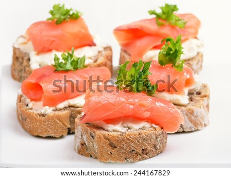 Fresh salmon snack with curd, close up view - stock photo