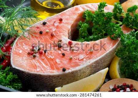 fresh salmon steak and ingredients for cooking, close-up, horizontal - stock photo