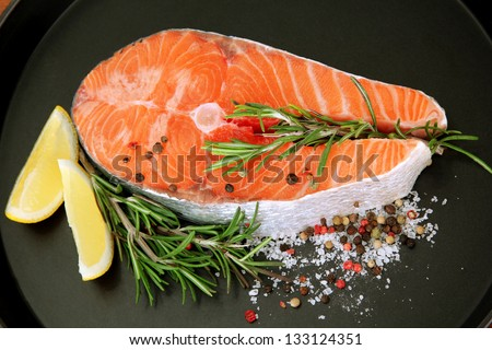 Fresh salmon steak on pan, close up - stock photo