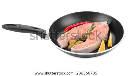 Fresh salmon steak on pan. Isolated on a white background. - stock photo