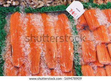 Fresh salmon steaks at at outdoor seafood market in Washington, DC - stock photo