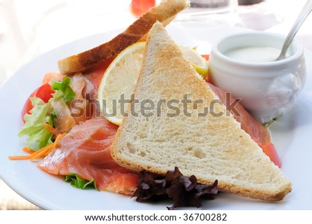 Fresh Salmon with lettuce - A seafood salad with smoked salmon