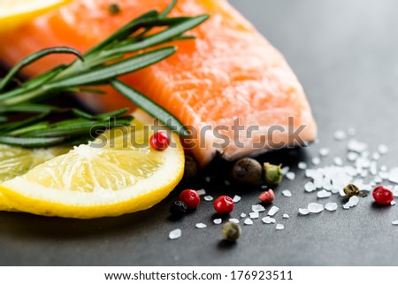 Fresh salmon with spices  - stock photo